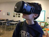 Student wearing a virtual reality visor
