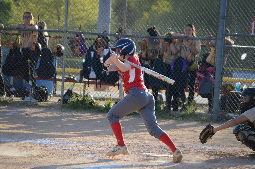 Student batting at a baseball game