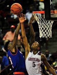 Basketball players playing a basketball game
