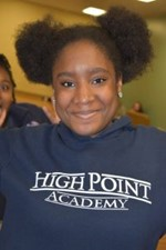 Student wearing a High Point Academy hoodie