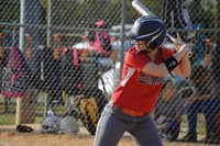 Softball player batting