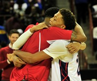 HPA Basketball Coach Marcus Watts hugging player after win